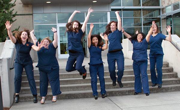 grads-jumping